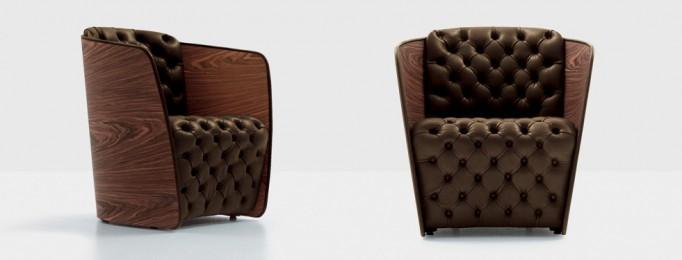 Sillónes con base de madera y asiento y respaldo de capitoné