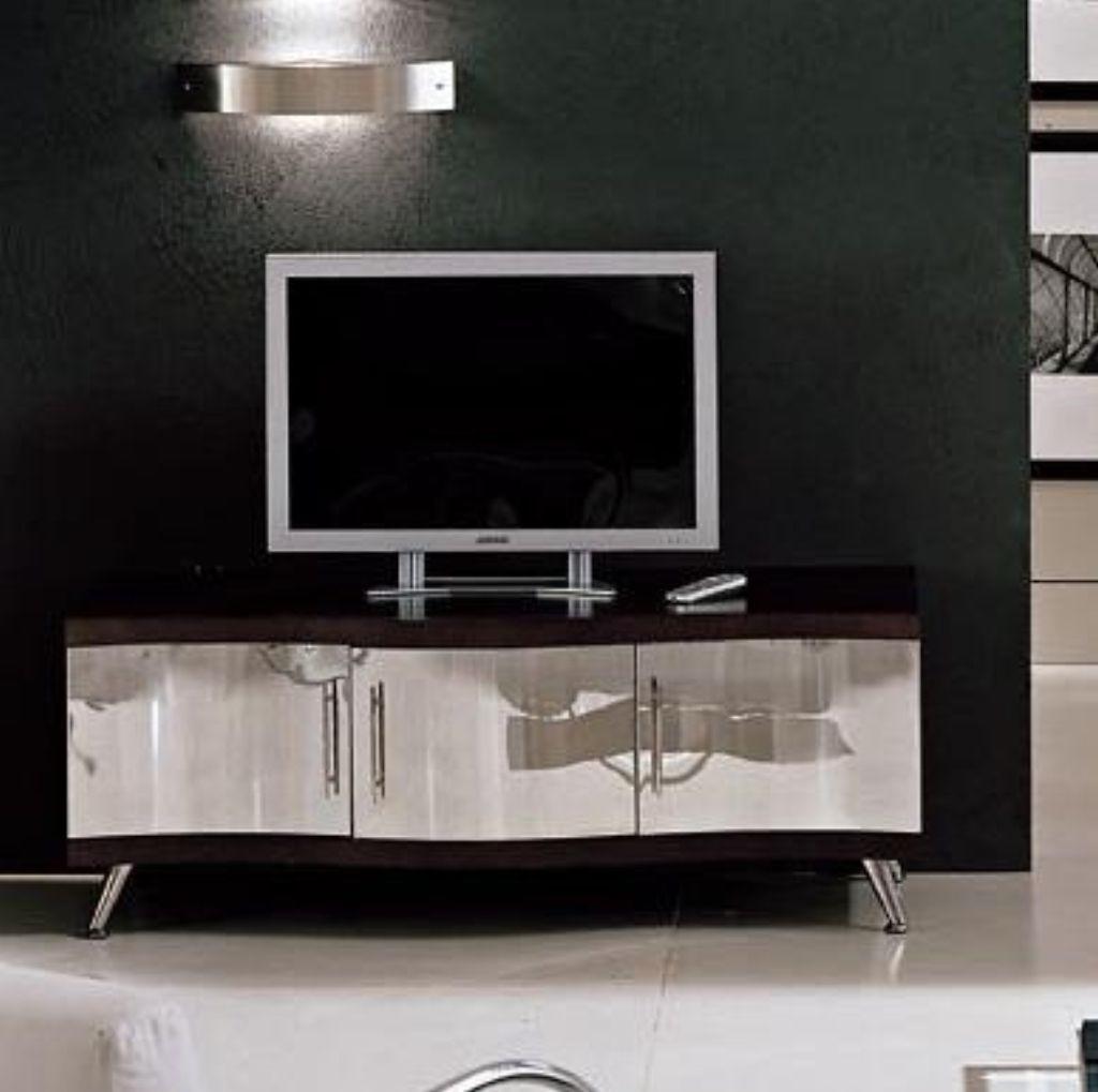 Mueble de tv de formas curvas, de acero inoxidable