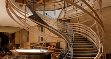 Wooden-strips-coil-around-staircase-at-Strasbourg-hotel-by-Jouin-Manku_dezeen_13