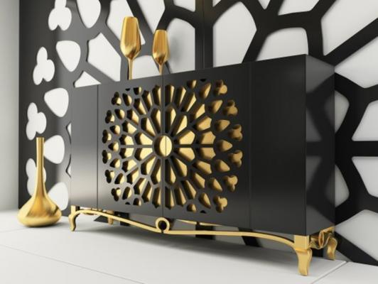 Un aparador contemporaneo que combina el oro y la laca negra.