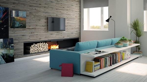 Un vivo tono turquesa del sofá que se convierte en el centro de atención de la estancia.