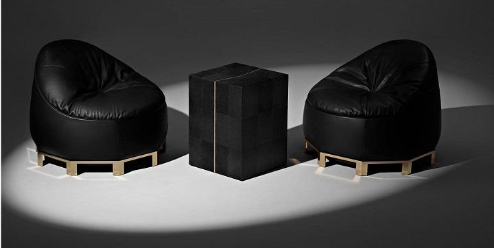 De piel negra y bronce pulido es este diseño de Alexander Wang.