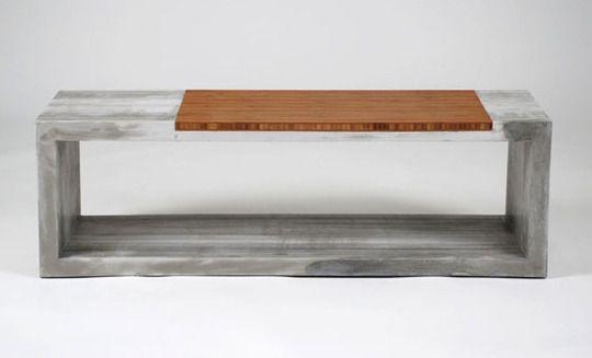 Un sencillo banco de cemento y madera, con estilo minimalista.
