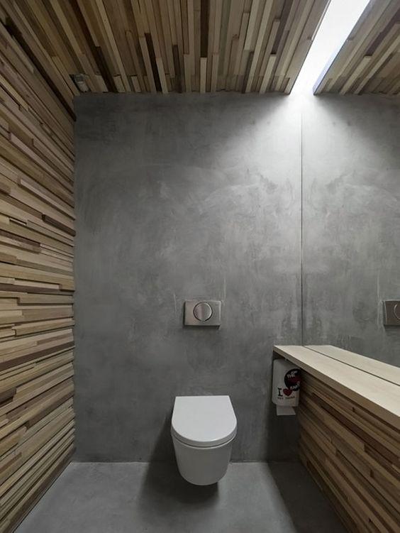 Las distintas texturas y materiales, confieren carácter a este moderno baño.