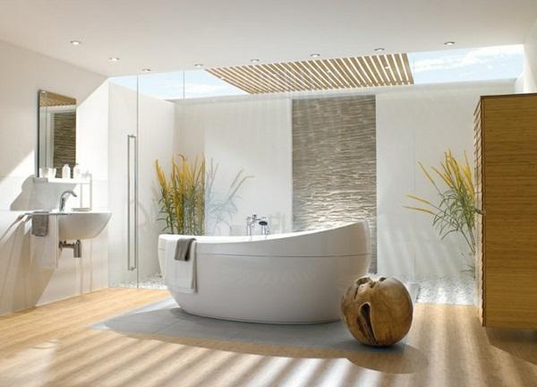 Piedra y cristal, dominan la zona de ducha, de este cuarto de baño.