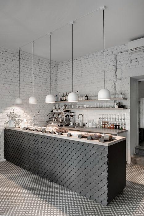 Una en tono gris, a contraste con el resto de la estancia en color blanca.