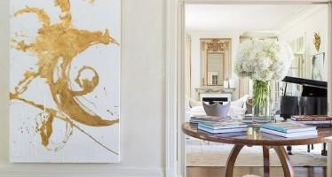 center-of-room-round-foyer-table-large-gold-abstract-art