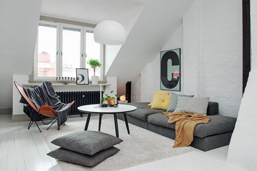 En este ático de Suecia, con predominio del color blanco y detalles en gris y negro.