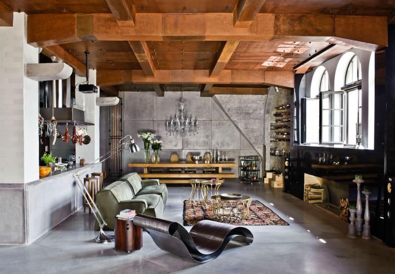 Vista lateral del salón con el comedor al fondo, de este loft con mezcla de estilos decorativos.