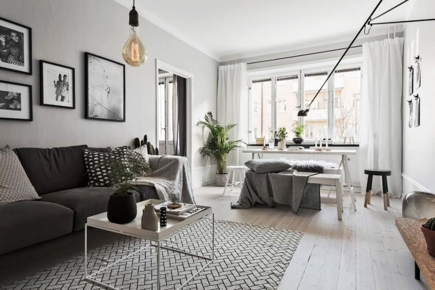Una decoración que coordina grises blancos y negros, con un estupendo resultado.