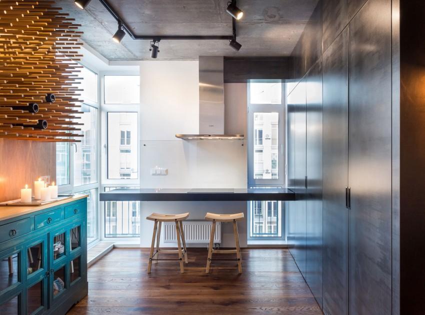 La cocina de este apartamento, combina distintos materiales.