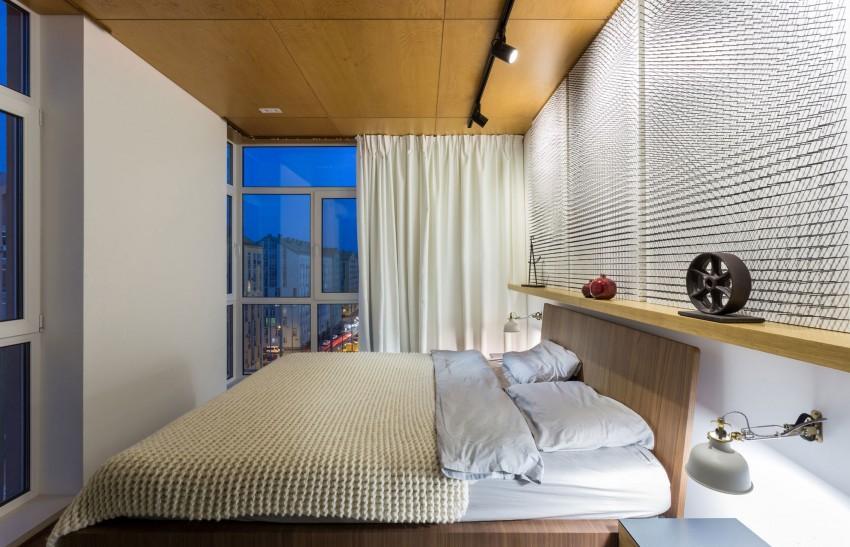 Un dormitorio de marcado estilo minimalista, en madera y blanco.