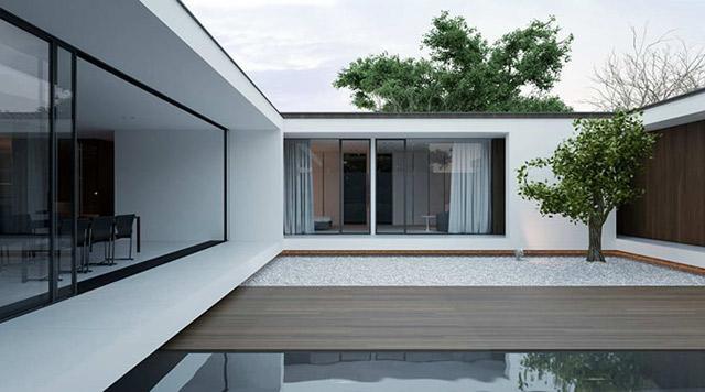 Un patio interior, que juega con los mismos materiales y tonos del resto de la propiedad.