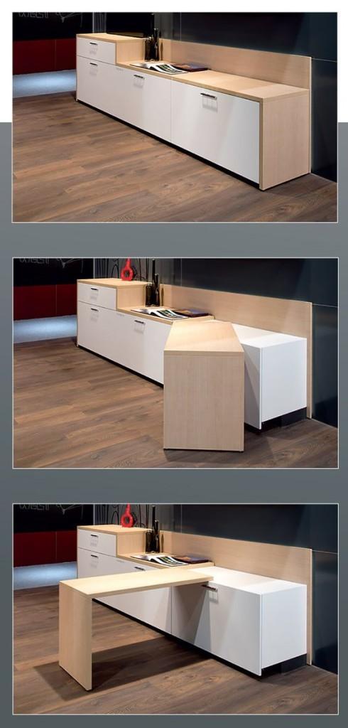 Una cocina blanca. con una encimera de madera que rota.
