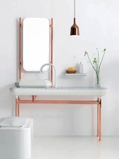 Un diseño de mueble para el baño, en color cobre y blanco.