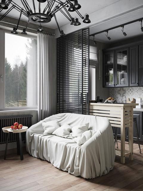 La combinación de la dureza y frialdad de los tonos grises, se contrarresta con la calidez de la madera.