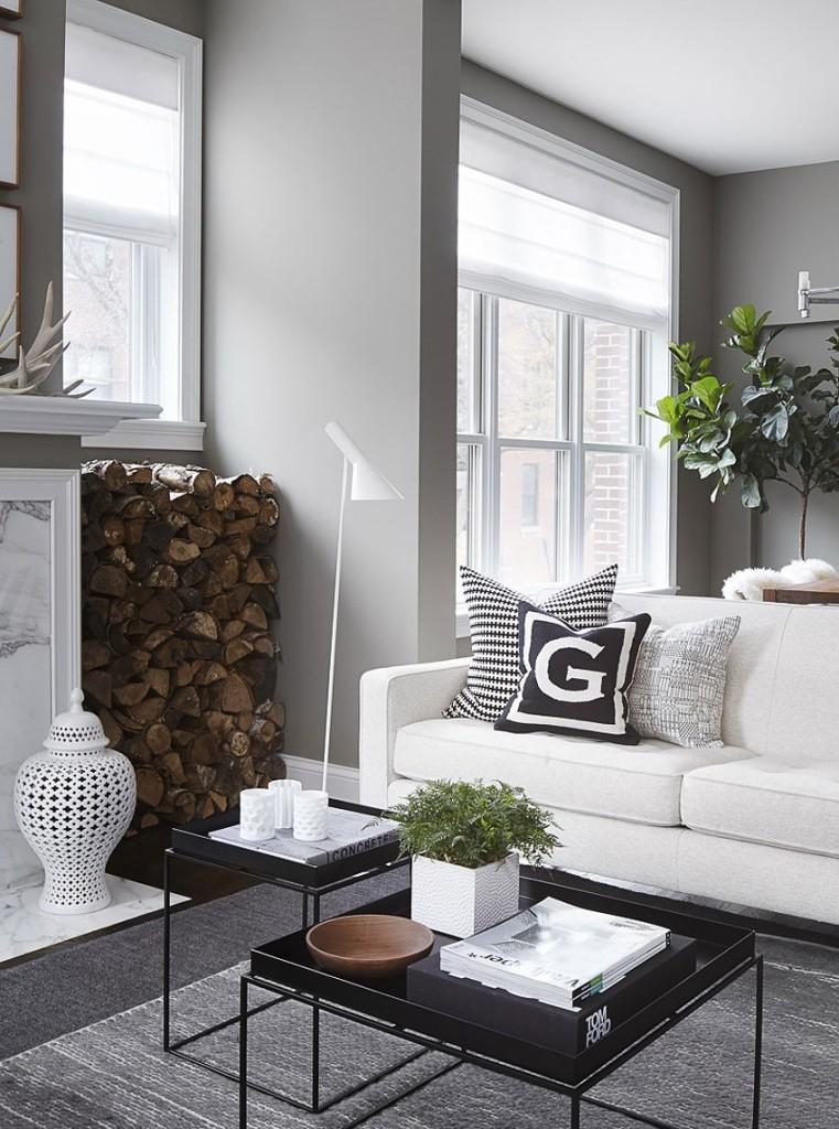 Algunas piezas en color negro. llaman la atención entre los grises y blancos de la estancia.