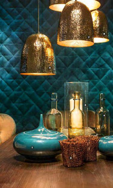 Azul petroleo, oro y tonos marrones forman una atractiva combinación.