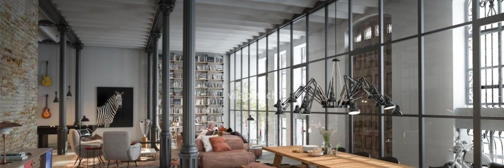 Una gran cristalera sirve de separador de ambientes en este loft.