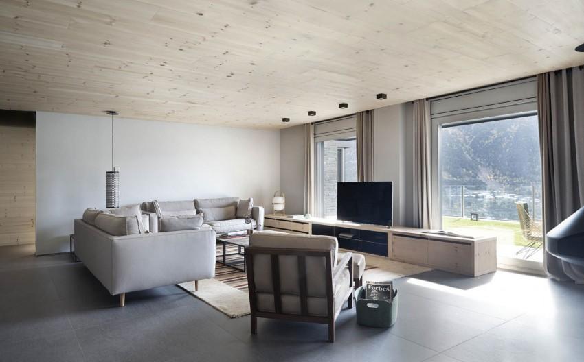 Tonos neutros, grises y beiges suaves combinados con madera natural.