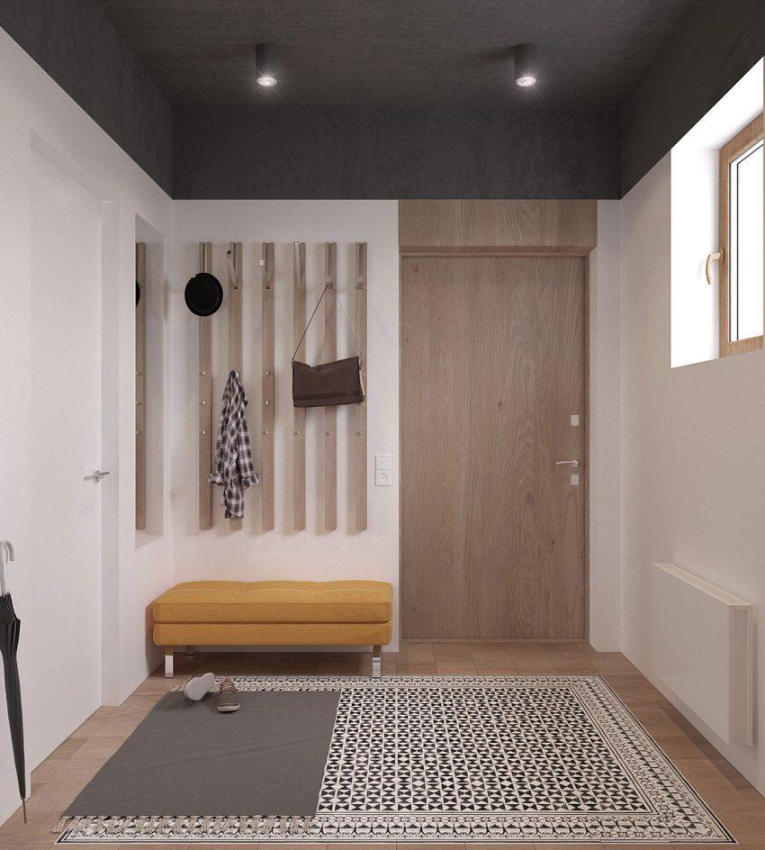 Una vivienda donde el color blanco , un profundo gris y la madera en tonos claros, dominan las estancias.