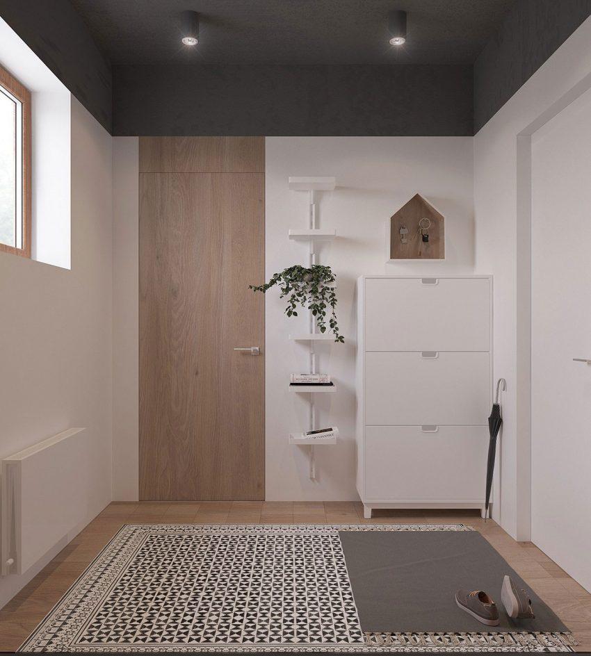 El recibidor cuenta con un interesante mosaico incrustado en la madera que cubre el suelo.