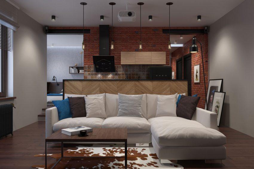 La zona de estar, el comedor y la cocina ocupan un mismo espacio compartido.
