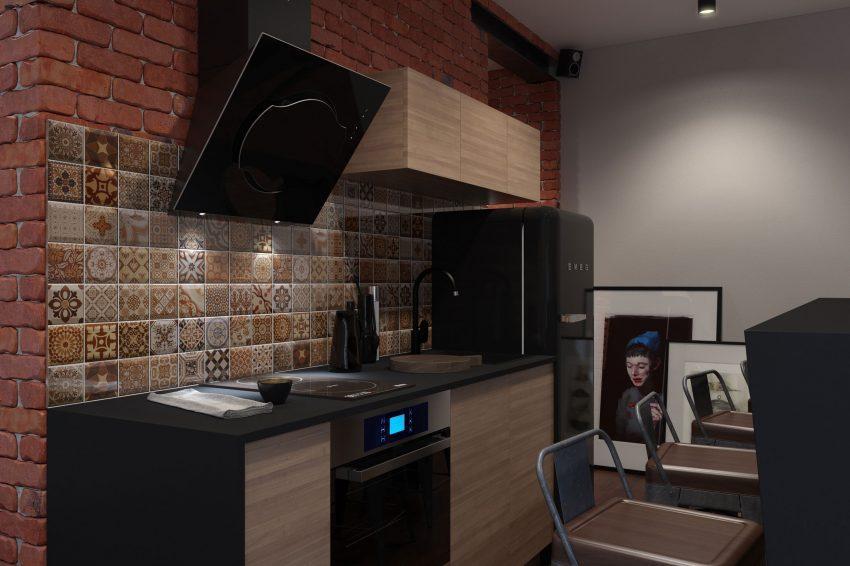 Sobre la pared de ladrillo visto de la cocina, se instalo un frontal de azulejos que imitan los diseños de las placas hidráulicas.