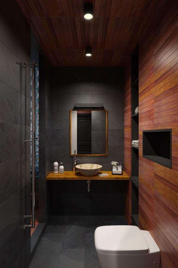 El uso de la madera de teca, y la pizarra le confieren calidez, a este moderno y práctico cuarto de baño.