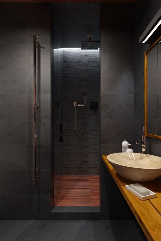 La zona de la ducha, cubierta totalmente con placas de pizarra y un suelo de madera de teca.