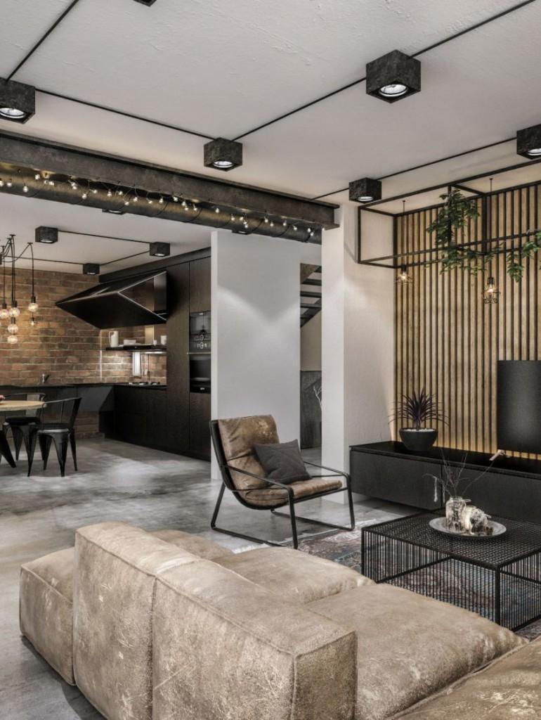 Imagen de parte del salón y la cocina de este original loft.