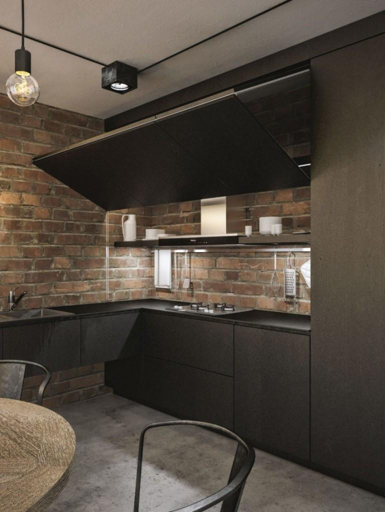 Tonos oscuros en el mobiliario de esta original cocina.