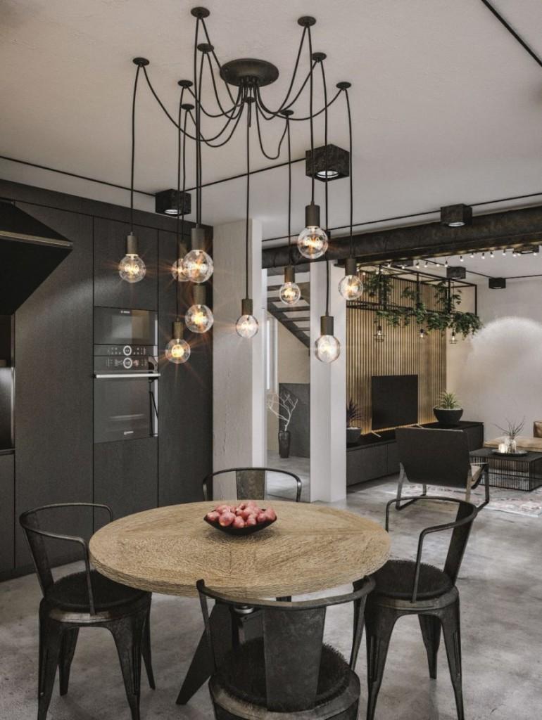 En este loft, tonos como los grises oscuros y los de las maderas dominan las estancias.
