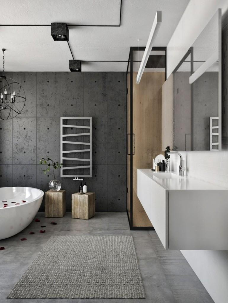 El estilo industrial, continua en el cuarto de baño combinado con toques minimalistas.