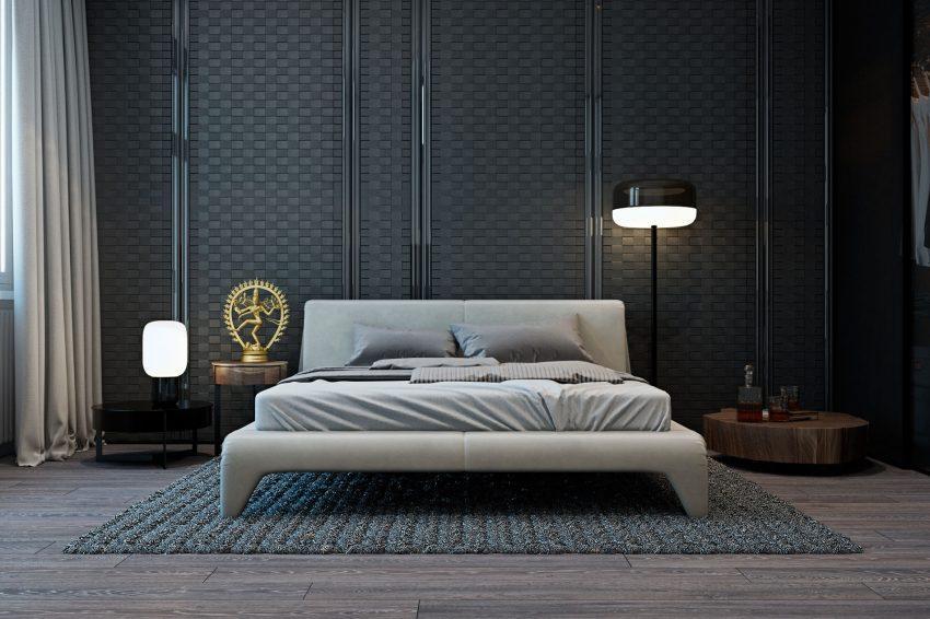 Dos modernas lámparas, una de pie y otra de sobremesa iluminan el dormitorio.