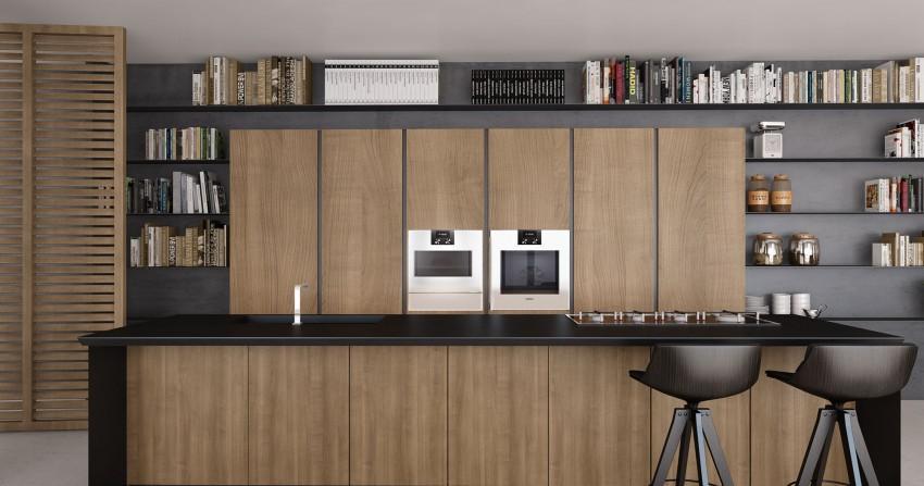 Una moderna cocina de estilo minimalista, en tonos madera y negros.