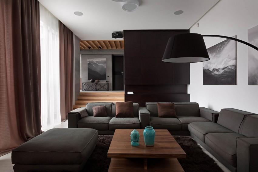 Marrones, negros y grises en el minimalista salón.