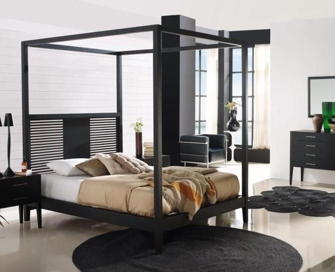 Un elegante y moderno dormitorio con cama con dosel.