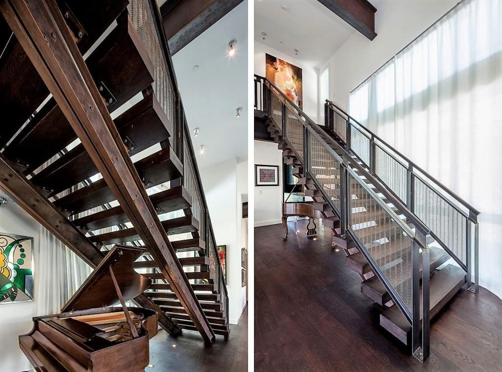 Una contundente y moderna escalera de metal y madera.