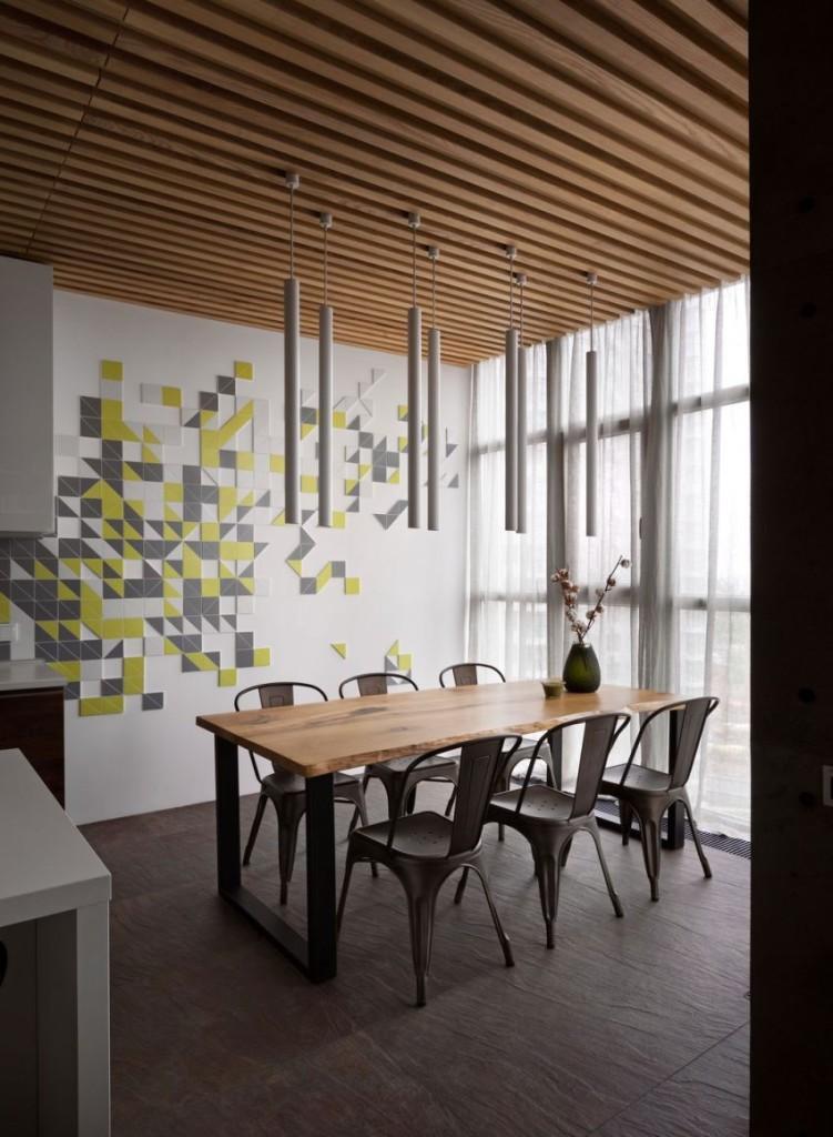 Un luminoso comedor con un diseño geométrico en las paredes.