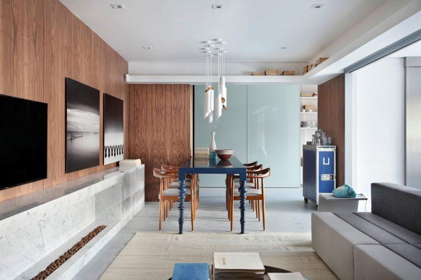 Imagen de parte de la zona de estar y el comedor de este apartamento.