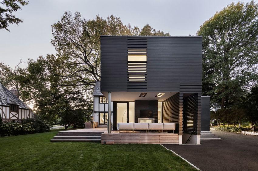 Una estructura moderna, abierta al jardín. como zona de ocio.
