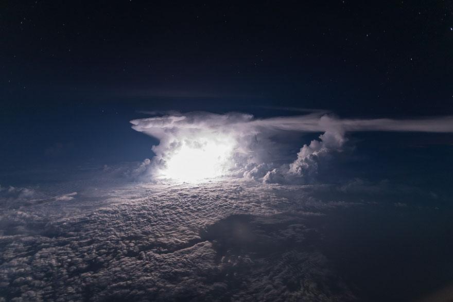 pilot-clouds-lightning-night-skies-santiago-borja-lopez-12-591954c76376a__880