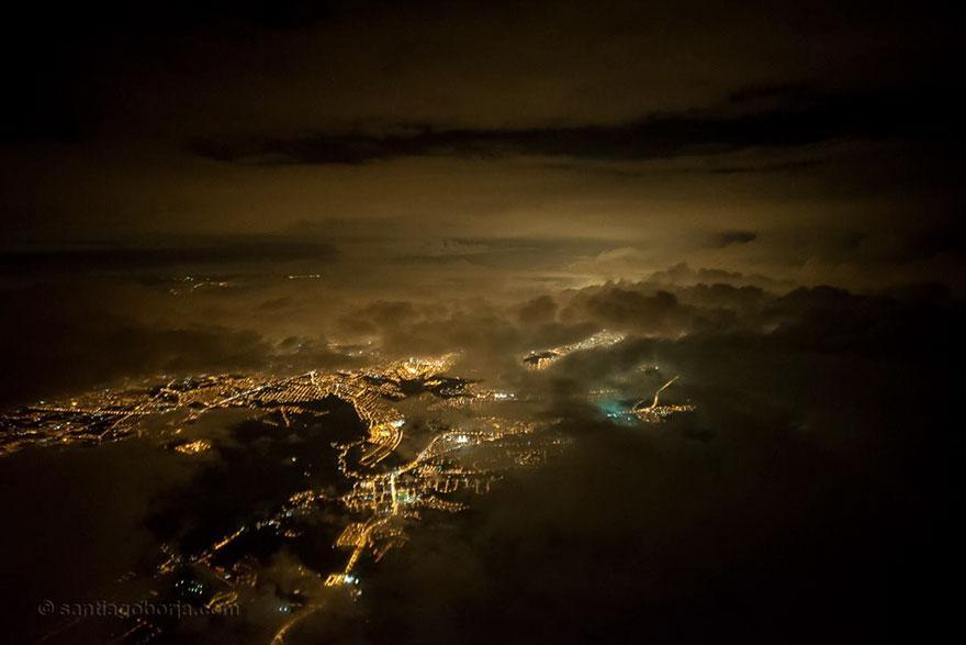 pilot-clouds-lightning-night-skies-santiago-borja-lopez-3-591954b55f12b__880